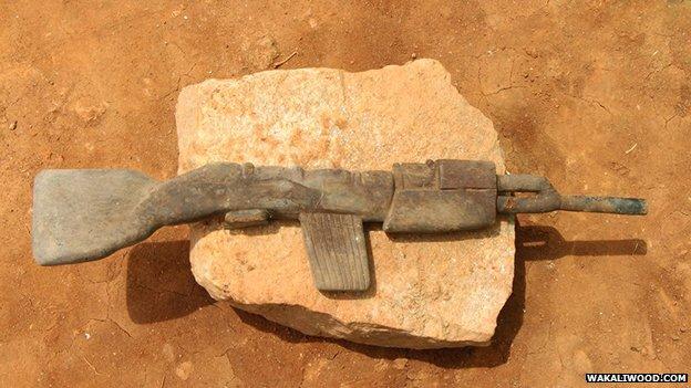 replica wooden machine gun