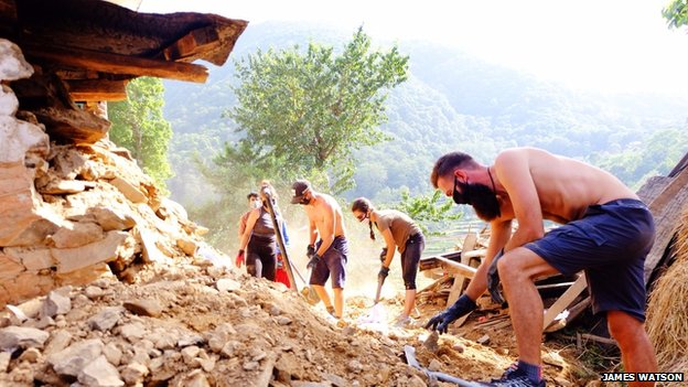 Clearing rubble in Ramkot