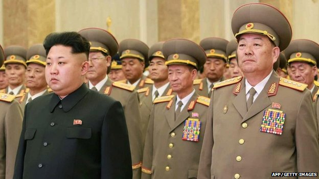 This photo taken on February 16, 2015 shows North Korean Defence Minister Hyon Yong-Chol (R) standing with North Korean leader Kim Jong-Un (front L) at Kumsusan Palace in Pyongyang