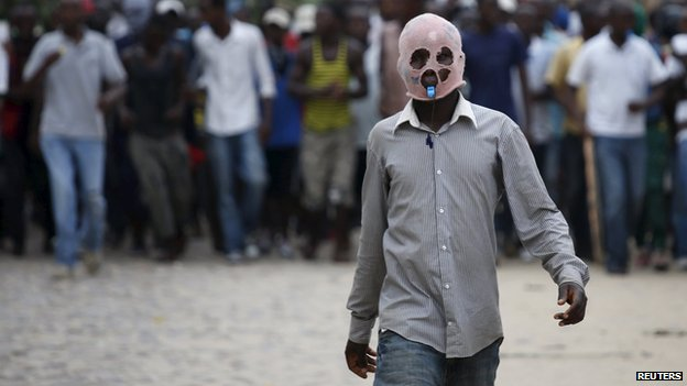 Masked protester in Bujumbura on 13 May 2015