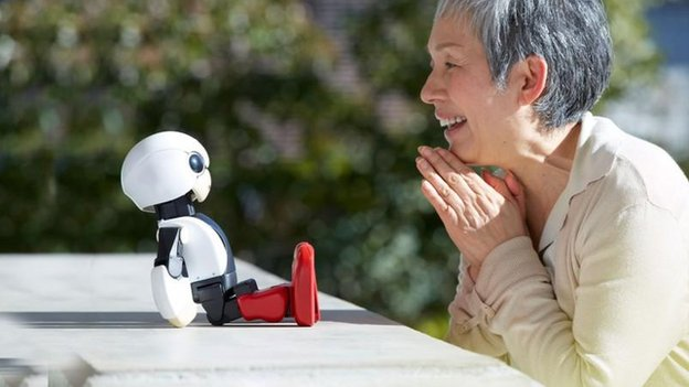 Older woman with robot