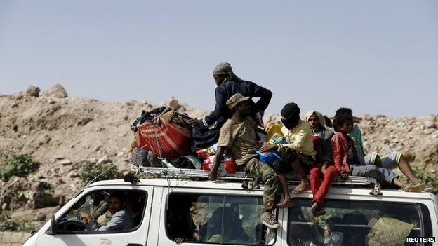 People flee an area of Yemen's capital, Sanaa, targeted by Saudi-led coalition aircraft (12 May 2015)