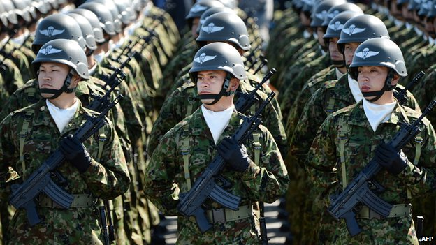 Japanese soldiers listen to Prime Minister Shinzo Abe during the military review at the Ground Self-Defence Force's Asaka training ground on October 27, 2013.