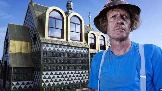 Grayson Perry in front of the house in Wrabness
