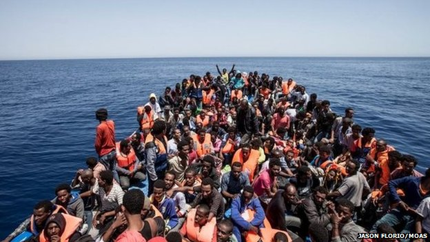 Migrants crowd the deck of their wooden boat off the coast of Libya, 14 May 2015