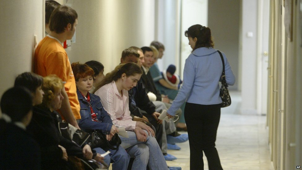 People sit in a hallway at the Saratov regional AIDS centre, 2006