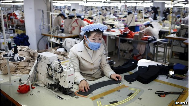 A North Korean employee works in a factory of a South Korean company at the Joint Industrial Park in Kaesong industrial zone, a few miles inside North Korea from the heavily fortified border in this 19 December 2013 file photo