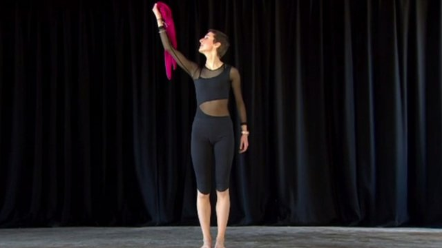 Amy Uprichard dancing on a stage