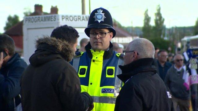 Police officer speaks to fans