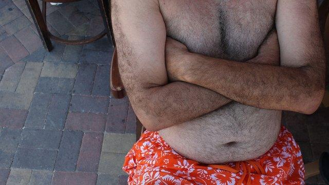 barechested man with slight tummy