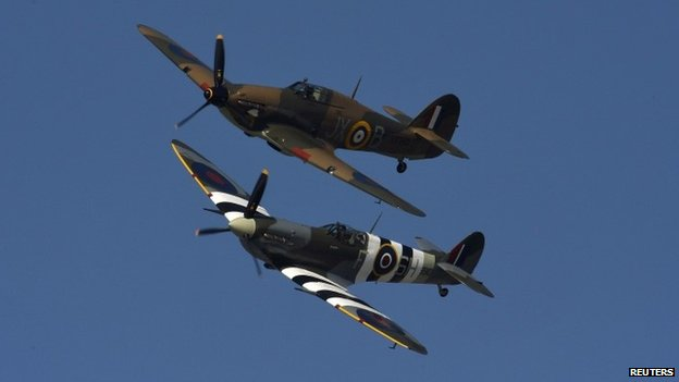 Hurricane and Spitfire planes perform a fly-past