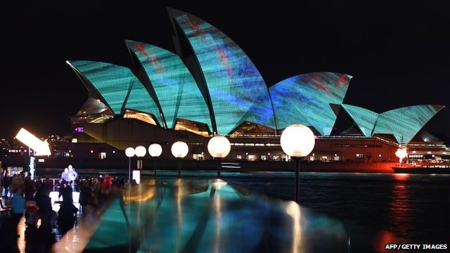 """A light show called """"Vivid"""" changes the appearance of the Sydney Opera House in Sydney"""
