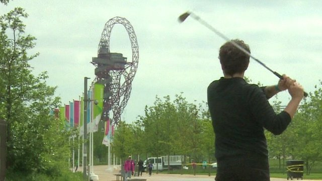 Man playing golf in Olympic park