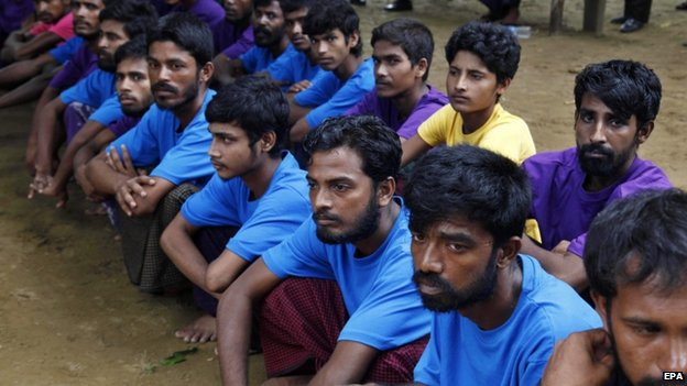 Rohingya Muslims from Bangladesh rescued by the Myanmar navy sit together at a temorary refugee camp in the village of Aletankyaw in the Maungdaw township of northern Rakhine state, Myanmar, 23 May 2015