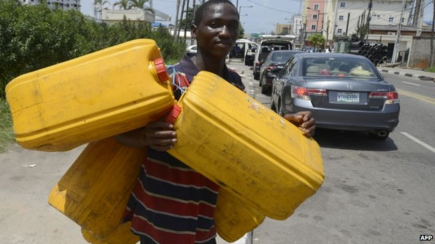 Man with jerry cans