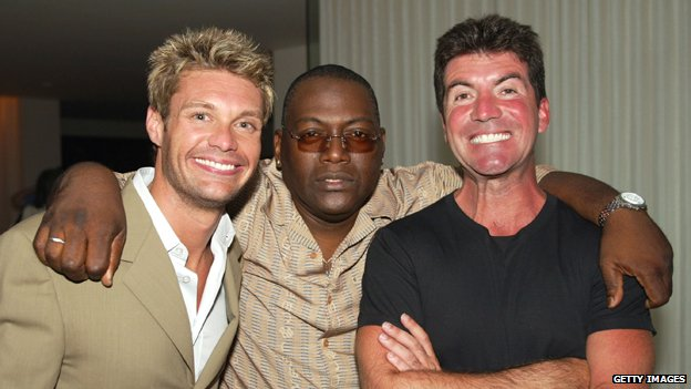 Ryan Seacrest and Simon Cowell showing off their white teeth