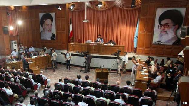 A general view of a courtroom shows suspected opposition supporters (in grey) attending the latest session in their trial at the revolutionary court in Tehran 25 August 2009.