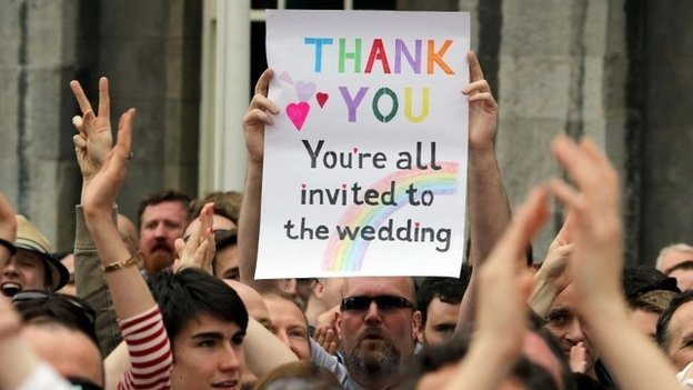 """A poster which states that """"everyone is invited to the wedding"""""""