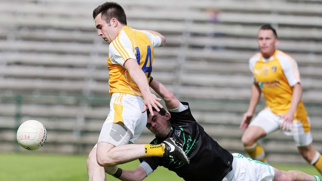 Antrim's Kevin Niblock scores past the Fermanagh goalkeeper in the 2014 Ulster Championship