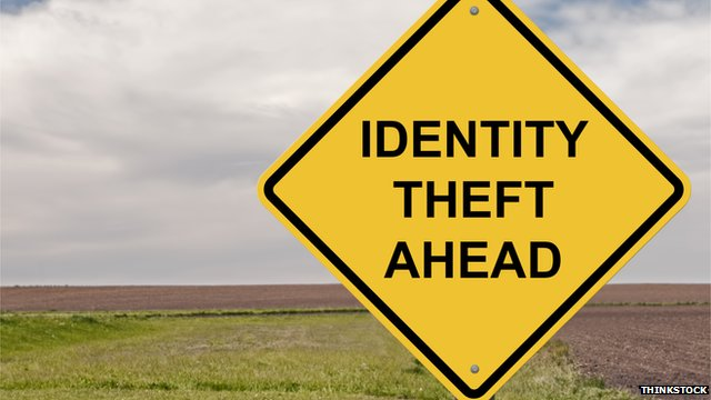 A road sign reads 'identity theft ahead'
