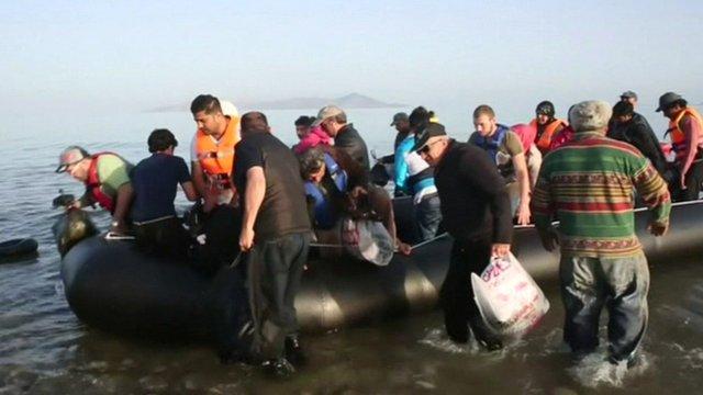 A boat full of migrants arriving in Kos