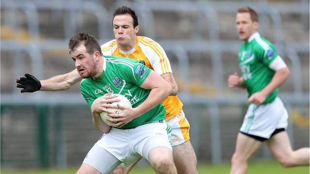 Fermanagh's Sean Quigley in action against Ricky Johnston of Antrim