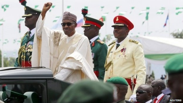 """Nigeria""""s new President Muhammadu Buhari rides in a motorcade while inspecting the guard of honour at Eagle Square in Abuja"""