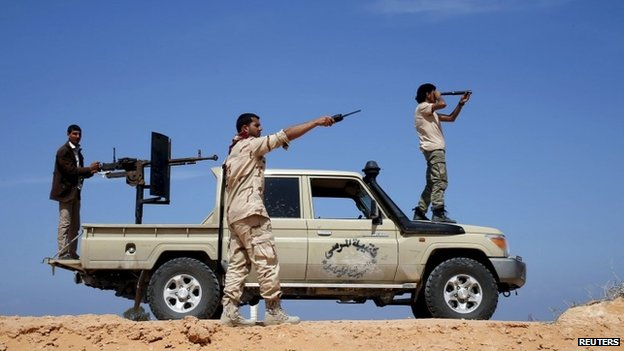 Libya Dawn fighters look at Islamic State (IS) militant positions near Sirte March 19, 2015.