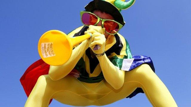 Man playing vuvuzela at SA world cup