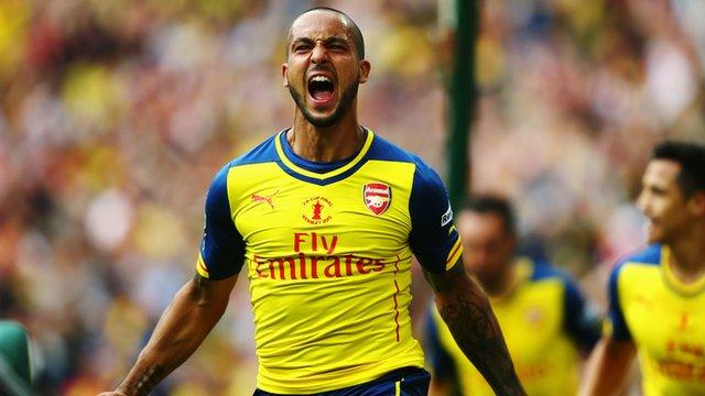 Arsenal's Theo Walcott celebrates scoring at Wembley