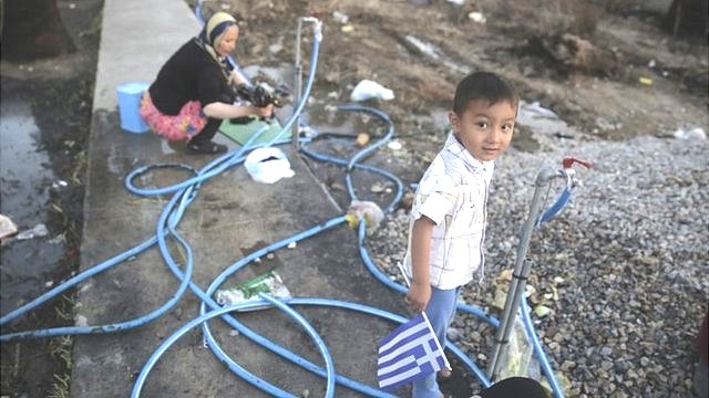 Afghan migrant child and mother in Kos