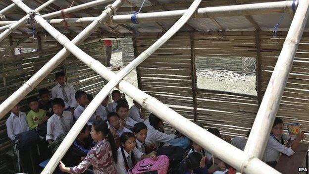 A school class in a temporary bamboo shelter in Bungmati, Nepal
