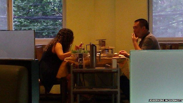 Couple smoking while eating at a hotpot restaurant in Shanghai