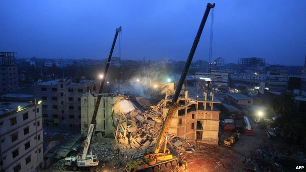 Cranes operated by Bangladeshi army personnel at the scene of the Rana Plaza disaster (29 April 2013)
