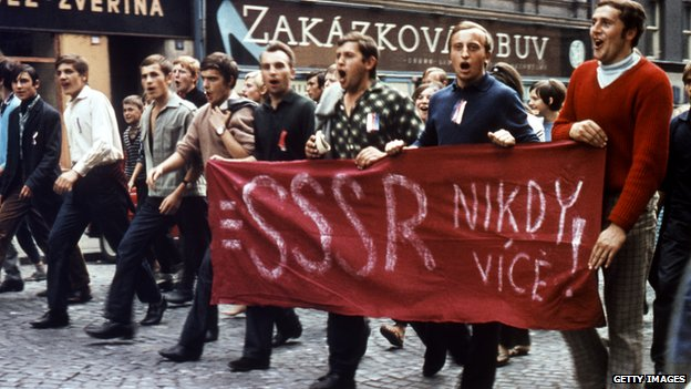 "Czech protesters hold a banner in 1968 reading ""USSR, never again"""