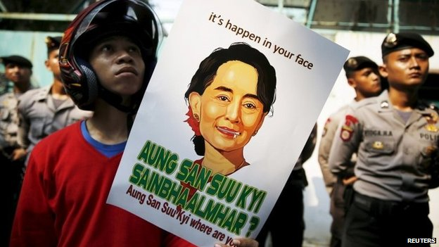 Student holds poster of Aung San Suu Kyi