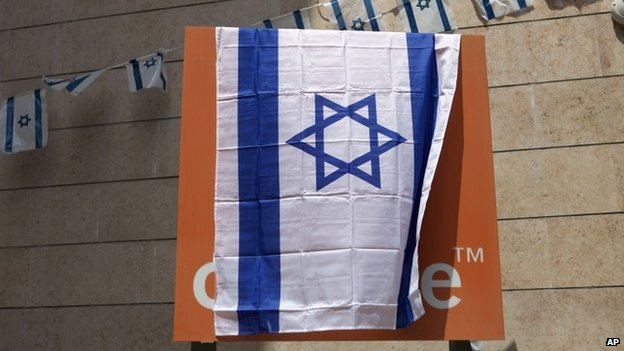 "The Orange company logo is seen covered with an Israeli flag at the ""Partner Orange"" Communications Company""s offices in the city of Rosh Haain, Israel, Thursday, June 4, 2015."