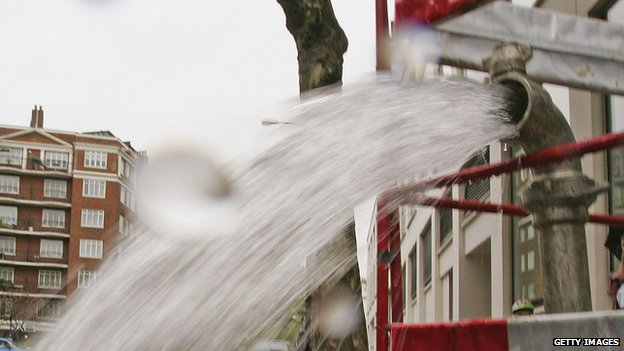A burst pipe spews water onto a street near Lancaster Gate on May 16, 2006 in London, England.