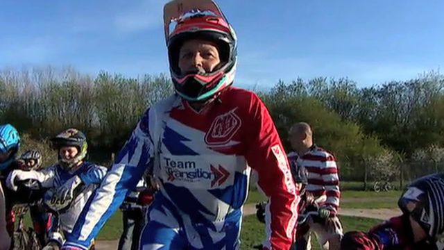 Paul Mounsey on his BMX ready to race