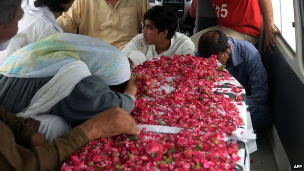 Pakistani relatives react next to the coffin of convicted activist Saulat Ali Khan also known as Saulat Mirza, following his execution in Karachi on May 12, 2015