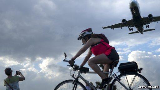 plane, bike, photographer