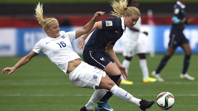 France's Amandine Henry (R) is tackled by England's Katie Chapman