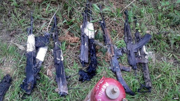 "In this photograph taken on June 4, 2015, weapons of the Indian army personel who were killed by militants lie at the scene of an attack on a military convoy in a remote area of Chandel district, about 120 kilometres (75 miles) southwest of northeastern Manipur""s state capital Imphal."