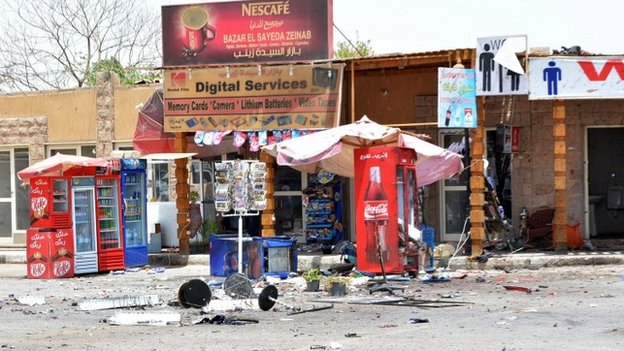 Debris is seen near shops damaged during a foiled suicide attack in Luxor, Egypt, June 10, 2015