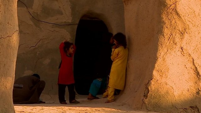 Children outside cave