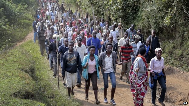 Demonstrators opposed to a third term for President Nkurunziza march before army soldiers shot in the air to disperse the protest, in the rural area of Mugongomanga, east of the capital Bujumbura, in Burundi
