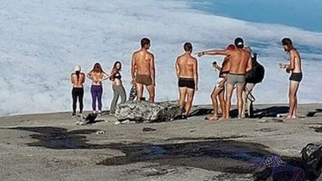 Photo of tourists on mountain