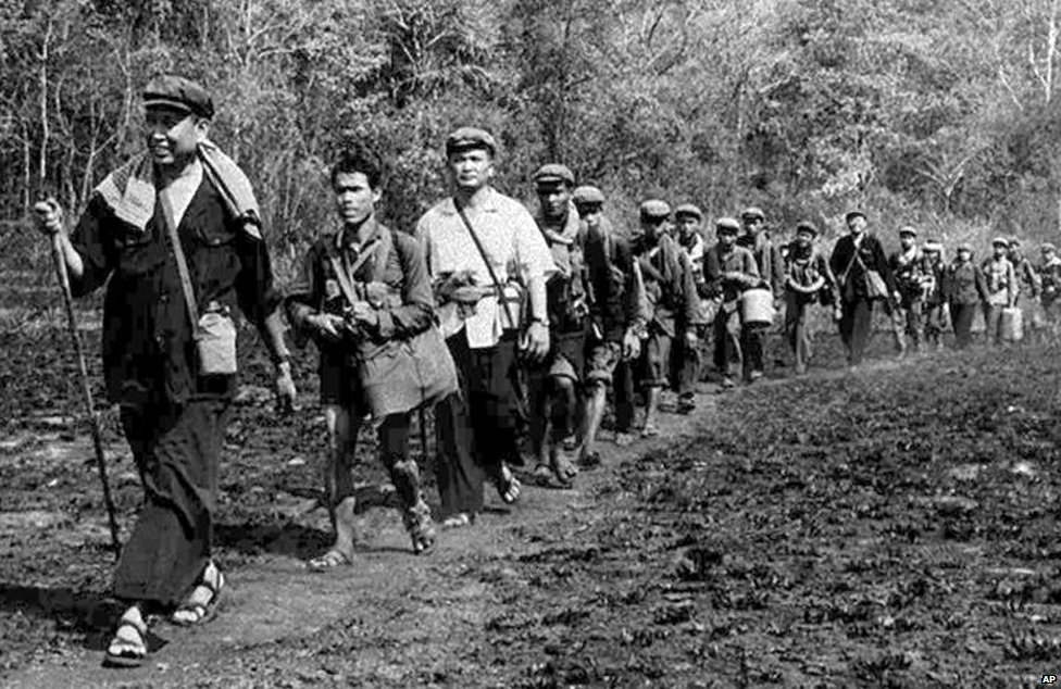 Pol Pot leading a group of his men
