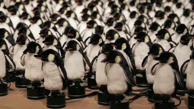 A mechanical mirror of 450 penguins at New York's bitforms gallery