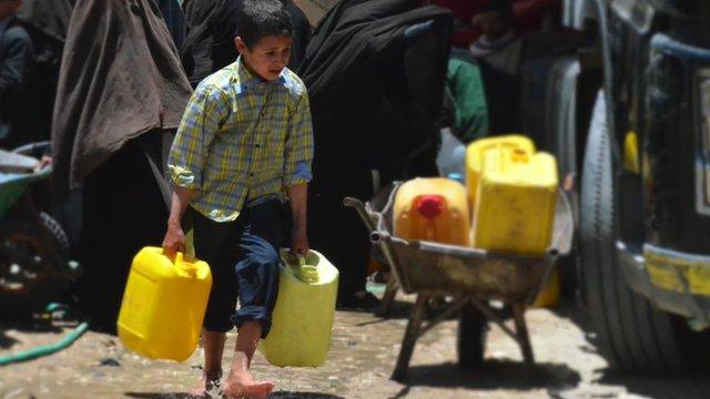 Yemeni boy carrying water